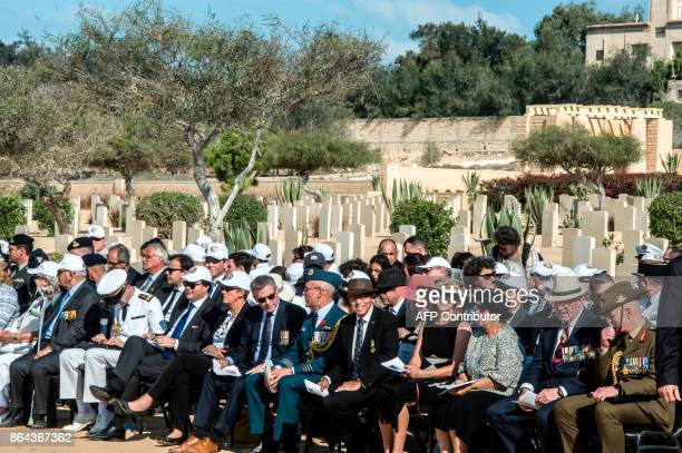 A picture taken on October 21 2017 shows delegations attending a ceremony at El Alamein War Cemetary marking 75 years since the pivotal WWII battle...