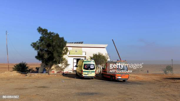 A picture taken on October 22 2017 shows ambulances parked at a medical emergency station on the desert road towards the Bahariya Oasis in Egypt's...