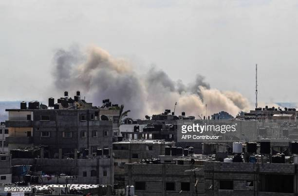 Picture taken on October 22 in Rafah in the southern Gaza Strip along the border with Egypt, shows smoke billowing from Egypt's North Sinai. / AFP...