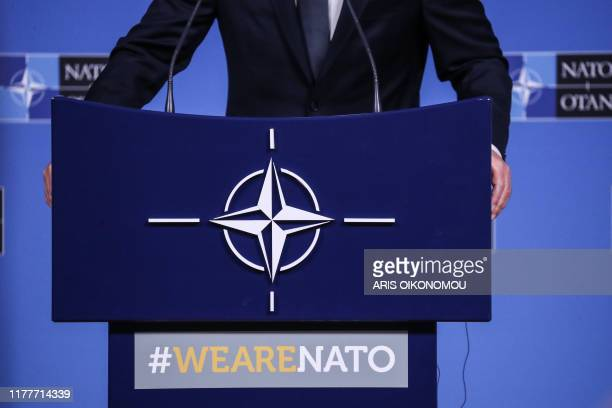 A picture taken on October 23 2019 shows as the NATO logo as NATO Secretary General Jens Stoltenberg talks to journalists during a press conference...