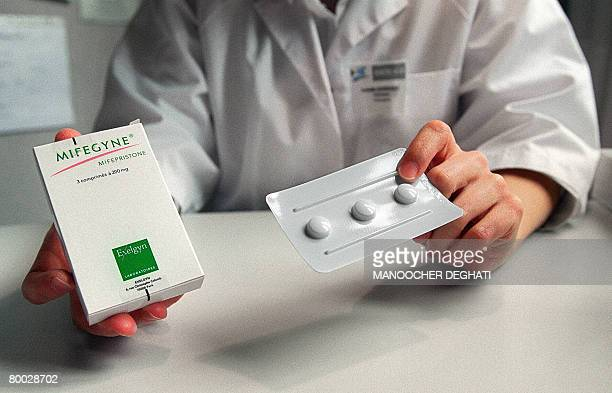 Picture taken on October 25 2005 of a nurse showing a box of the RU486 pill at the family planning department of Hopital Broussais The national...