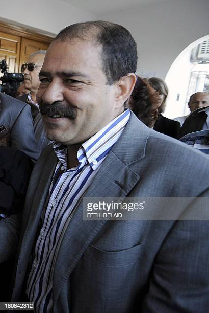 A picture taken on October 25 2012 shows Tunisian lawyer Chokri Belaid standing outside the Manouba court near Tunis Prominent Tunisian opposition...