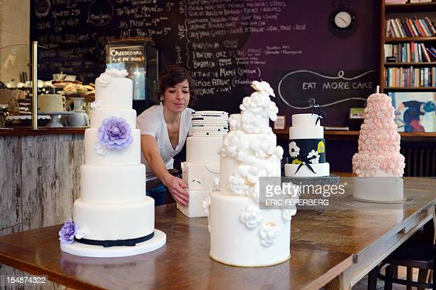 A picture taken on October 26 2012 shows wedding cakes at the Sugarplum cake shop in Paris From 'Kate'inspired lace dresses to towering wedding cakes...