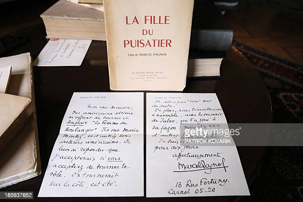 A picture taken on October 26 2013 in MarneslaCoquette outside Paris shows a letter sent by French writer Marcel Pagnol with one of his books to late...