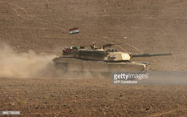 A picture taken on October 26 2017 shows an Iraqi forces' M1 Abrams main battle tank advancing towards the town of Faysh Khabur which is located on...