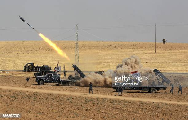 Picture taken on October 26, 2017 shows rockets being launched from Iraqi security forces' against Kurdish Peshmerga positions in the area of Faysh...