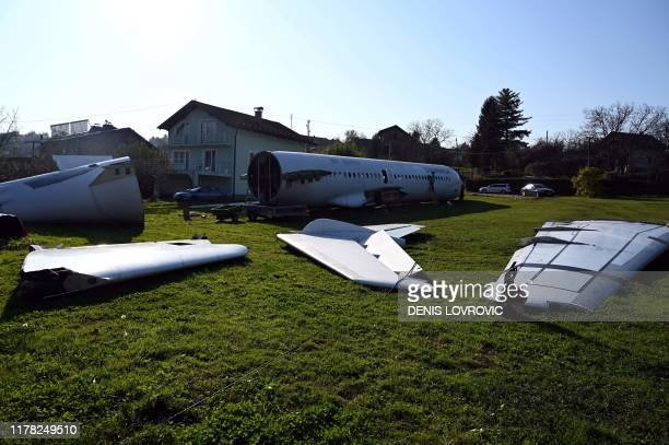 A picture taken on October 26 2019 shows the body wings and tail of a SunAdria Holland Fokker100 aircraft in the garden of a Croatian citizen in...