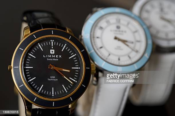 """Picture taken on October 27, 2011 in Neuchatel of watches from Swiss brand """"Limmex"""", the World's first watch fitted with a miniaturised GSM mobile..."""