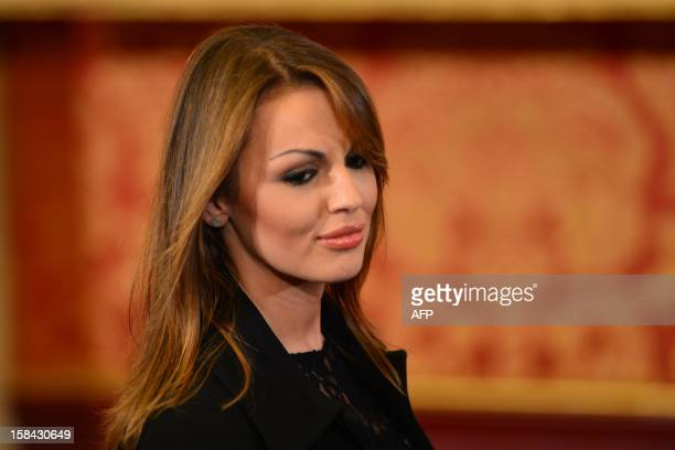 A picture taken on October 27 2012 shows Francesca Pascale at villa Gernetto in Lesmo near Monza Silvio Berlusconi during a television show announced...