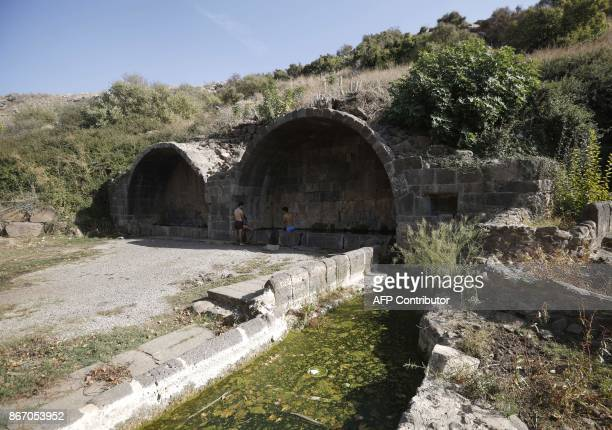 A picture taken on October 27 2017 shows youth swimming at the archaeological site of Umm elQanatir dated to the 6th8th centuries located south of...