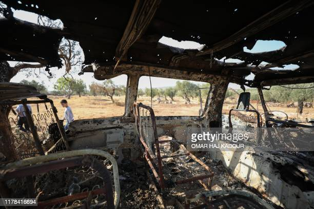 A picture taken on October 27 2019 shows a burnt vehicle near the site where helicopter gunfire reportedly killed nine people near the northwestern...