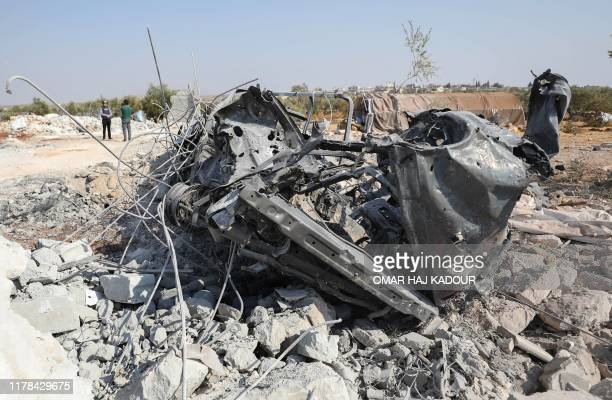 A picture taken on October 27 2019 shows a destroyed vehicle at the site where helicopter gunfire reportedly killed nine people near the northwestern...