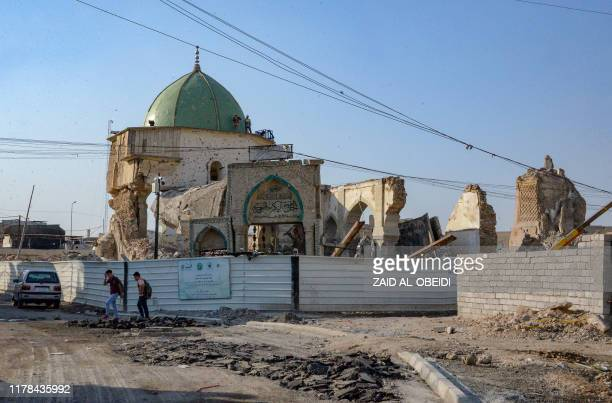 "Picture taken on October 27, 2019 shows Mosul's Al-Nuri Mosque and the remains of the destroyed ""Al-Hadba"" leaning minaret next to it in the former..."