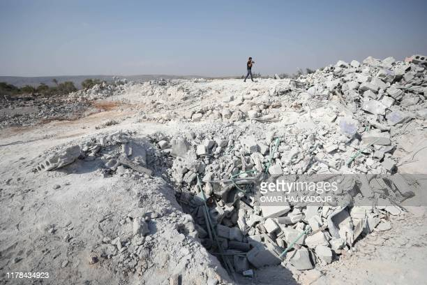 Picture taken on October 27, 2019 shows rubble at the site of helicopter gunfire which reportedly killed nine people near the northwestern Syrian...