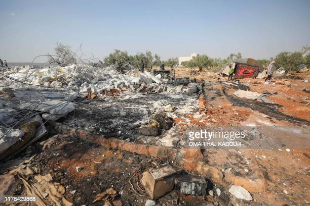 A picture taken on October 27 2019 shows the site of helicopter gunfire which reportedly killed nine people near the northwestern Syrian village of...