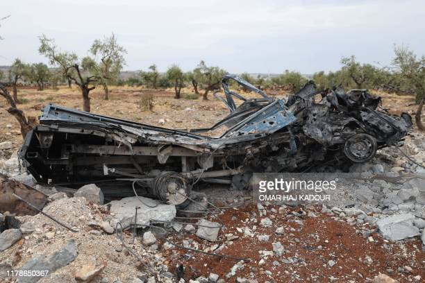 Picture taken on October 28, 2019 shows a vehicle wreck amid the rubble at the site of a suspected US-led operation against Islamic State chief Abu...