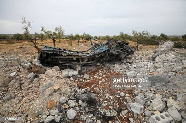 A picture taken on October 28 2019 shows a vehicle wreck amid the rubble at the site of a suspected USled operation against Islamic State chief Abu...