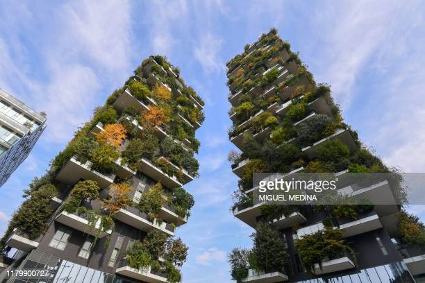 TOPSHOT A picture taken on October 28 2019 shows the Vertical Forest highrise complex in Milan viewed from the Porta Nuova Gardens The Vertical...