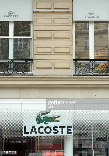 122c66115d27 A picture taken on October 29 2012 shows French clothing company Lacoste s  logos in front of