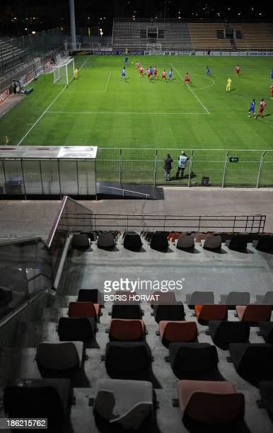 A picture taken on October 29 2013 shows empty seats in the tribunes as the French League cup football match Bastia vs Ajaccio is taking place behind...