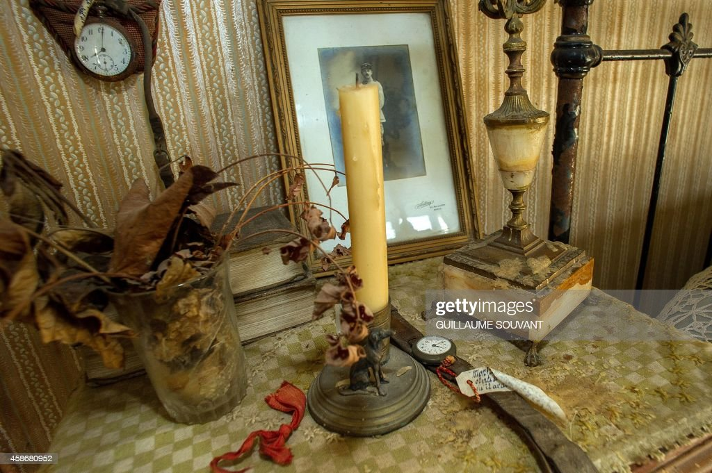 A Picture Taken On October 29, 2014 In Belabre, Central France, Shows Faded  Flowers On A Bedside Table In The Bedroom Of French Word War I Second  Lieutenant ...