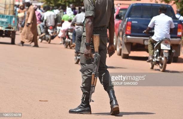 Picture taken on October 29, 2018 shows a policeman patrolling in the center of Ouahigouya, eastern Burkina Faso. - Parts of the North and East of...