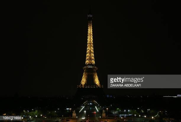 A picture taken on October 29 2018 shows the Paris landmark Eiffel Tower as its lights are turned off in honour of the victims of the antiSemitic...