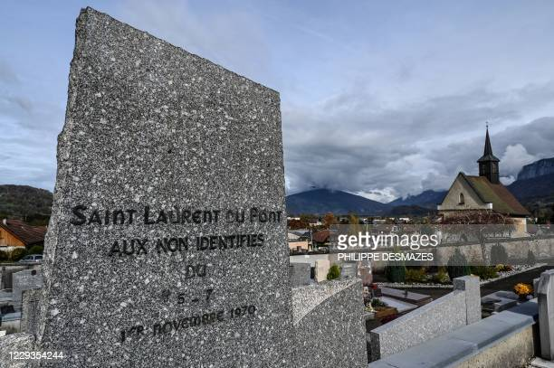 Picture taken on October 29 in the cemetery of Saint-Laurent-du-Pont, south-east France, shows a grave in tribute to the 146 victims of a fire in the...