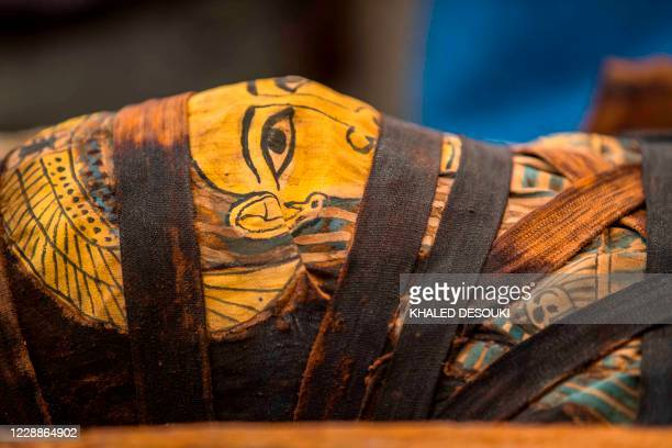 A picture taken on October 3 2020 shows a mummy excavated by the Egyptian archaeological mission which resulted in the discovery of a deep burial...