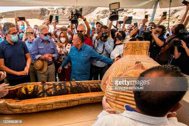 Picture taken on October 3, 2020 shows Egyptian actor Hussein Fahmy look on as Egyptian Minister of Tourism and Antiquities Khaled Al-Anani , and...