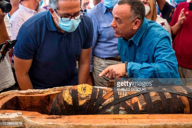 Picture taken on October 3, 2020 shows Egyptian Minister of Tourism and Antiquities Khaled Al-Anani , and Mustafa Waziri , Secretary General of the...