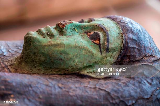 A picture taken on October 3 2020 shows one of the sarcophaguses excavated by the Egyptian archaeological mission which resulted in the discovery of...