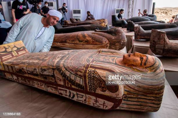 A picture taken on October 3 2020 shows sarcophaguses excavated by the Egyptian archaeological mission which discovered a deep burial well with more...