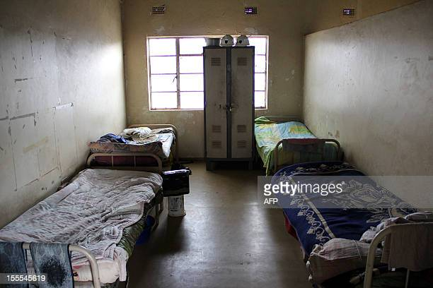 A picture taken on October 30 2012 shows a bedroom within an oldstyle mineworkers' hostel in Wonderkop near the Lonmin platinum mine in Marikana...