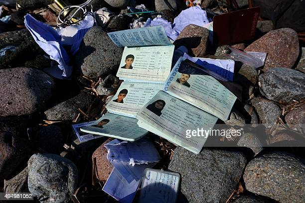 A picture taken on October 30 2015 shows the passports of members of a family who drowned after the boat transporting them sank on a beach on the...