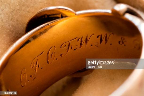 Picture taken on October 30, 2019 at the apartment of Arthur Brand in Amsterdam shows a close-up of the 18-carat golden friendship ring with an...