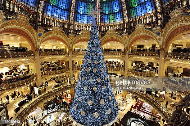 A picture taken on October 31 2012 at the Galeries Lafayette Paris department store shows a big Christmas tree decorating the central ground floor...