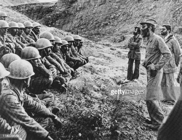 Picture taken on October 4, 1981 at the battlefront in Iran showing the future President of the country Ali Khamenei speaking to members of the Armed...