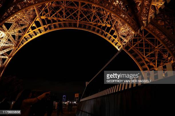 A picture taken on October 4 2019 shows the art installation titled Paris recadre travail in situ 2019 by French artist Daniel Buren under the Eiffel...