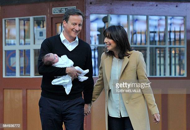 Picture taken on October 5, 2010 shows British Prime Minister, David Cameron, his wife Samantha, and their new baby Florence as they arrive at a...