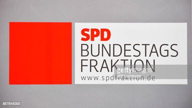 A picture taken on October 5 2017 shows the logo of the Social Democratic Party parliamentary group displayed at the Bundestag lower house of...