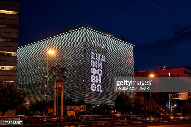 Picture taken on October 5, 2020 shows words from a famous song of the Greek rapper, Pavlos Fyssas, killed by a member of Golden Dawn Greek Neo-nazi...