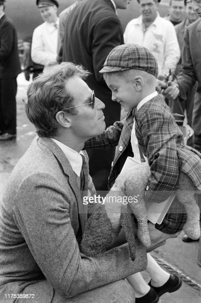 Picture taken on October 6 1960 at Orly airport showing American actor Charlton Heston welcoming his son Fraser arriving to meet his father before...