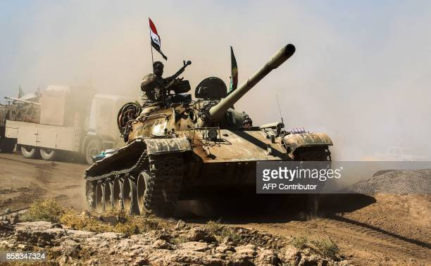 Picture taken on October 6, 2017 shows a tank belonging to the Furqat al-Abbas Brigade of the Hashed al-Shaabi paramilitaries advancing towards...