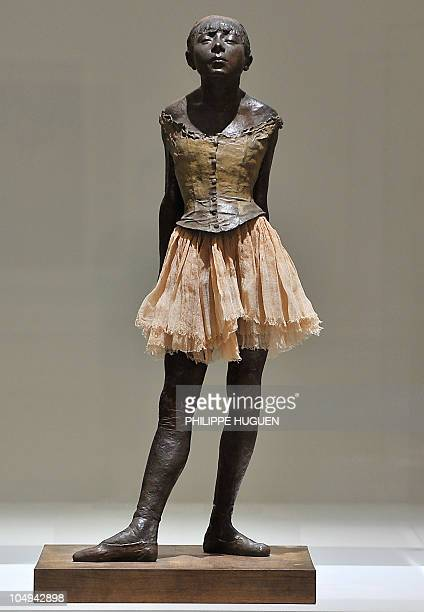 A picture taken on October 7 2010 shows the sculpture The Little Dancer of Fourteen Years by French artist Edgar Degas at the La Piscine art museum...