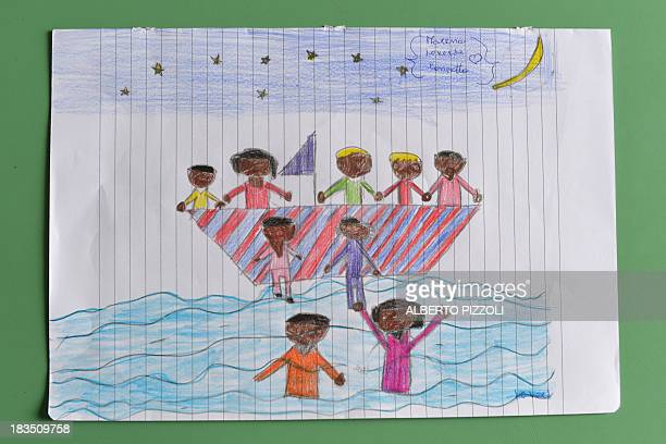A picture taken on October 7 2013 in an elementary school of the Italian island of Lampedusa shows a child's drawing telling the story of the tragic...