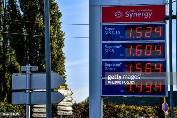 A picture taken on October 8 2018 in Bailleul northern France shows a board showing prices at an oil station as the European standards impose on...