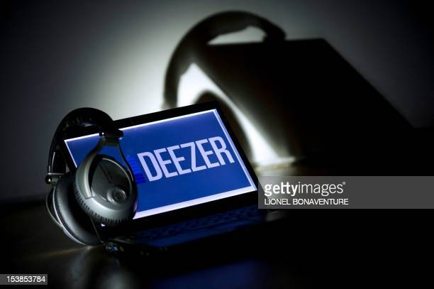 A picture taken on October 9 2012 in Paris shows headphones hanging on a laptop computer displaying the logo of French music streaming website Deezer...