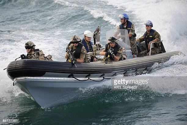FILES Picture taken on on December 23 2008 shows German soldiers taking part in a maneuver to secure the frigates 'Karlsruhe'and...
