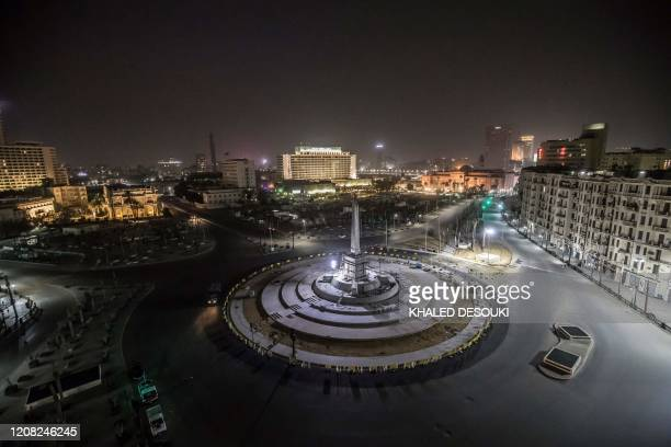 Picture taken on on March 25, 2020 shows Egypt's landmark Tahrir Square in the capital Cairo on the first evening of a two-week long night-time...